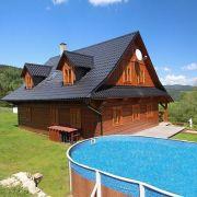 Domek cembrowany z basenem i sauną